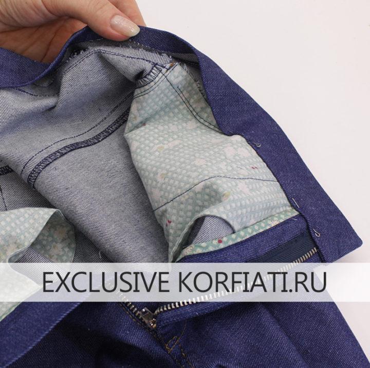 Обработка пояса на джинсовых брюках